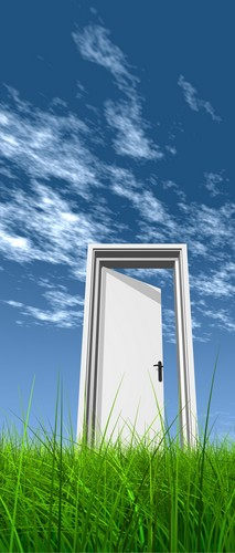 Door opened in grass to the sky